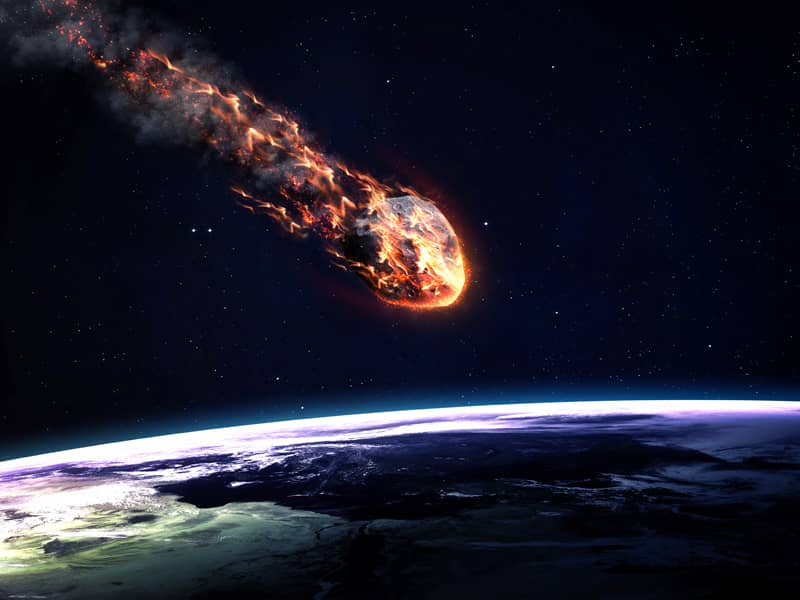 Asteroid striking Earth