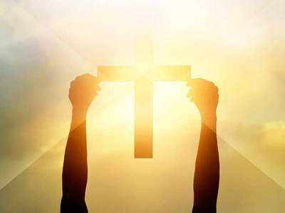 hands holding cross