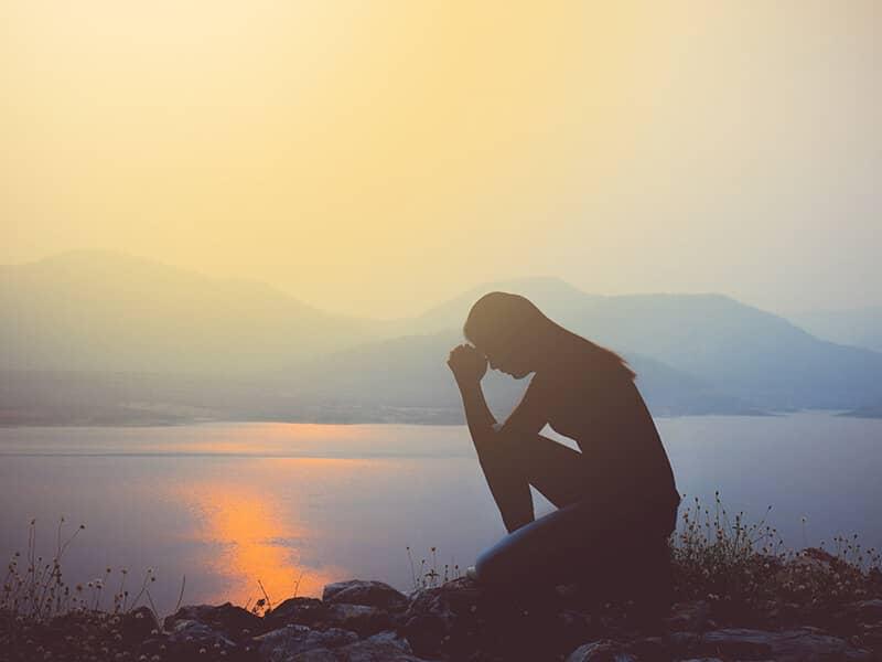 praying and reflecting at shore