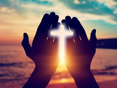 Hands on cross