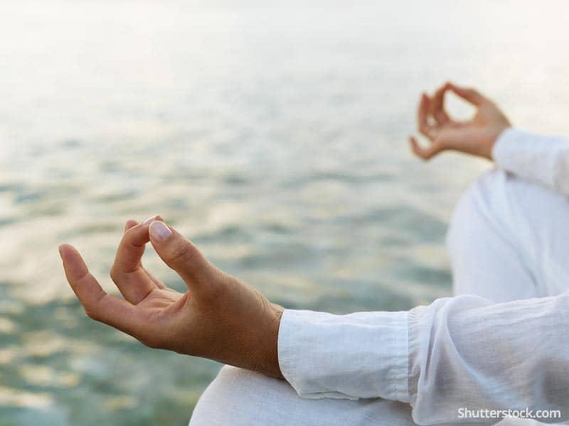man-meditation-peace-ocean