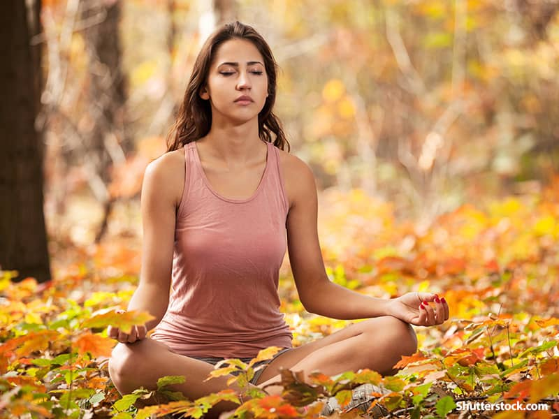 people woman meditating forest