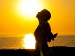 Woman Praise at Sunset