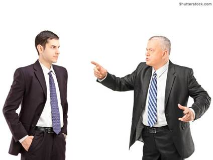 boss pointing finger at employee