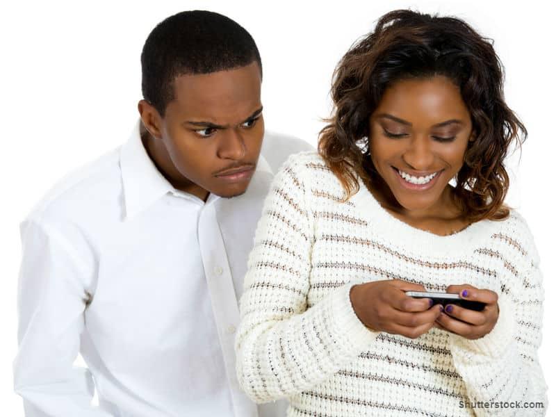 Boyfriend peering at Girlfriend's Phone