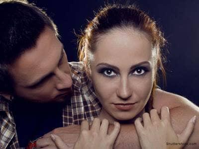 Man's arm around girlfriend