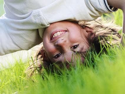Kid in grass