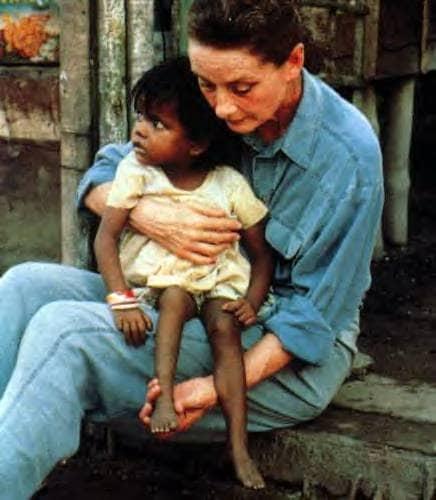 Hepburn holding child