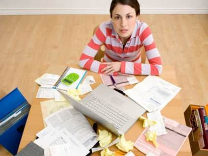 Woman at Cluttered Desk