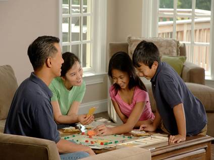 Family Playing Monopoly