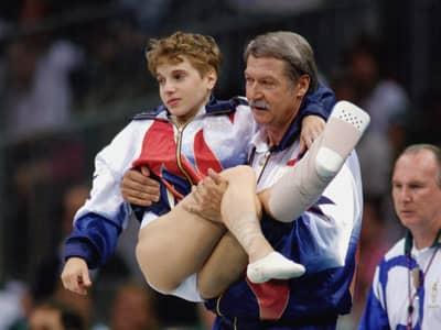 Kerri Strug at the 1996 Olympics with Coach Bella Karolyi