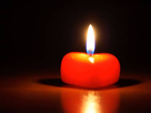 Heart-shaped red candle