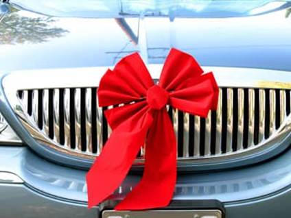Car with a red bow