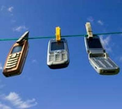 Cell phones hanging on a clothes line