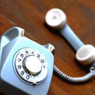 Light blue old-fashioned rotary phone