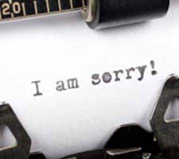 Typewriter with a I am Sorry! note