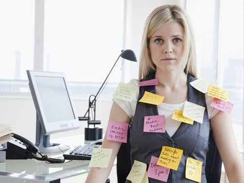Woman with Post-Its stuck on her