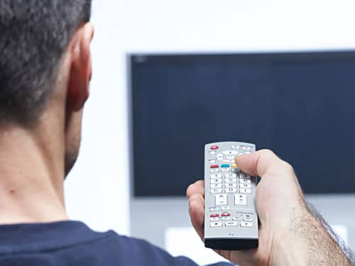 Man with a remote control in his hand