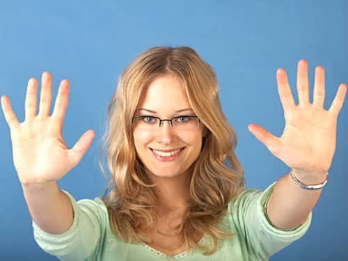 Woman with her hands up