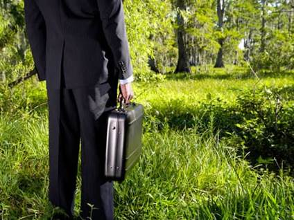 Businessman in a forest