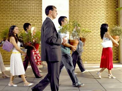 People carrying plants