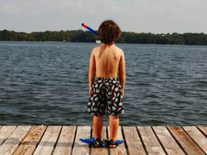 Boy with Arms by Sides on Dock