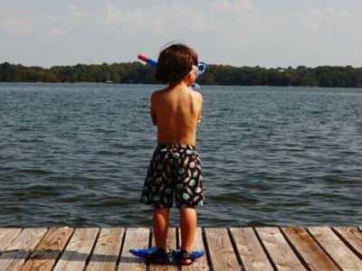 Boy on Dock, Arms Crossed Looking