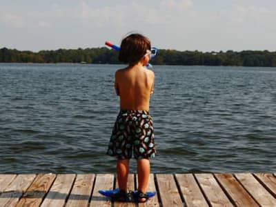 Boy on Dock, Arms Crossed Looking