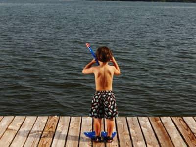 Boy on Dock, Hands on Head