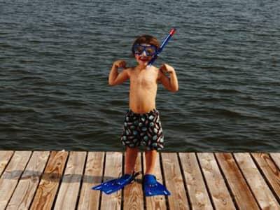 Strong Arms, scuba boy on dock