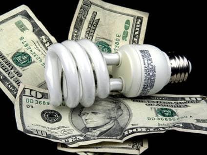 Compact fluorescent light bulb on ten dollar bills