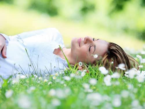 Woman lying in a field of flowers