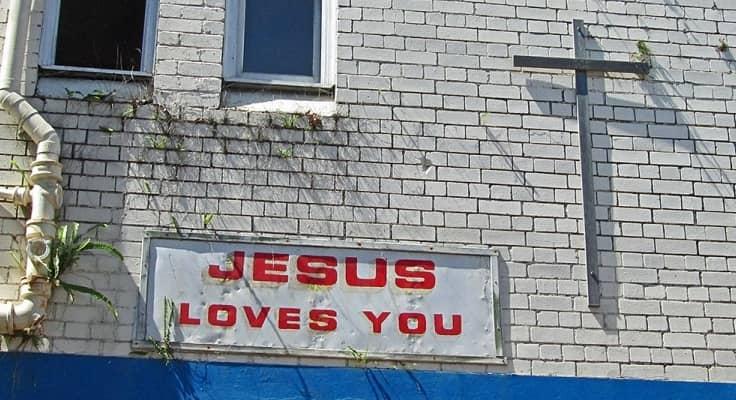 Jesus Loves You on a brick building