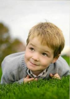 boy laying in grass