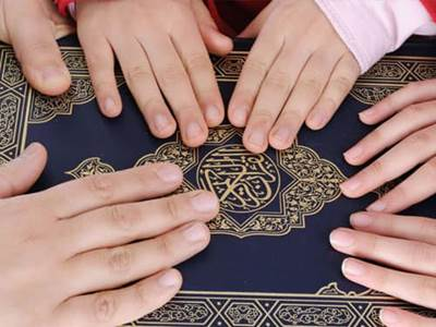 Family Hands on Bible