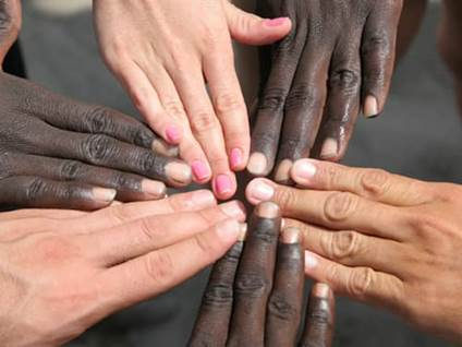 Circle of multi ethnic hands