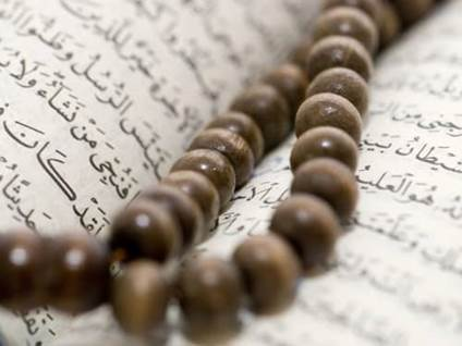 Muslim Prayer beads on Quran