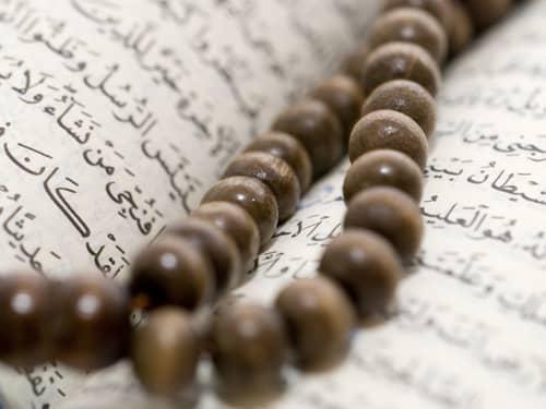 Muslim Prayer beads on Quran