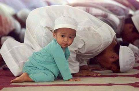 Muslim toddler during prayer