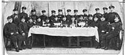 Jewish-Russian soldiers posing at a table.