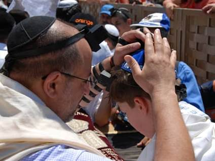 Jewish man and child bar mitzvah at western wall