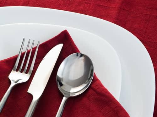 Red napkin with silverware utensils