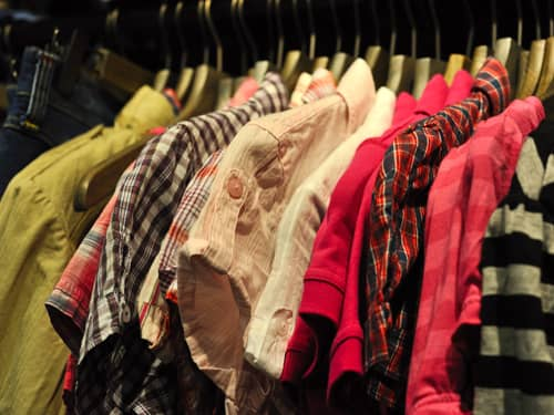Old clothes hanging in a closet