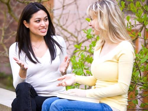 Two girl friends talking