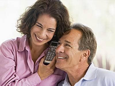 Happy couple on phone