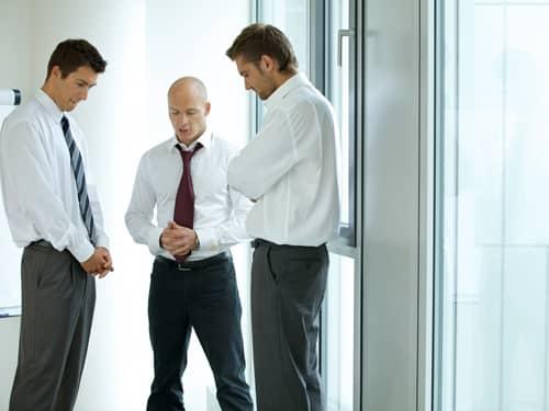 Three men before a meeting