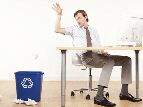 Man throwing garbage into the trash