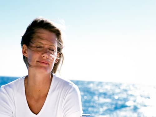 Relaxed woman by the sea