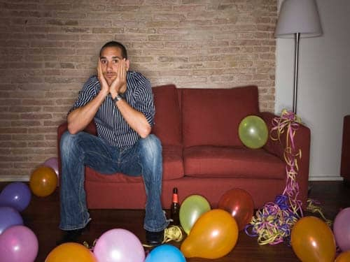 Sad man at birthday party