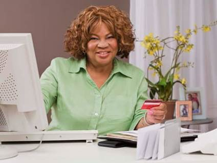 Happy woman at a desk